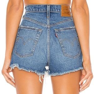 Vintage high waisted levi's shorts in medium blue
